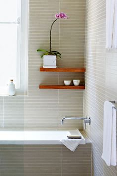 Scala '200' curved wall bath spout; Sussex 'Pol' single towel rails, all from Reece.