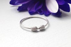 This fidget ring has a minimalist look to it and looks great worn alone or stacked with other rings.