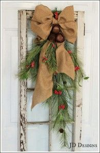 Rustic-bells and greens on window