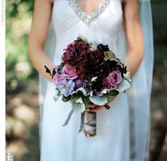 bouquet of hydrangeas, chocolate cosmos, ranunculus, dahlias, and lisianthus with accents of dusty miller and lamb's ear.