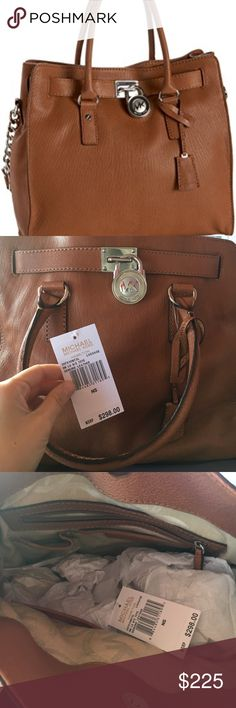 NEW WITH TAGS Michael Kors Hamilton purse NEW WITH TAGS AUTHENTIC NEVER WORN Michael Kors large Hamilton purse. luggage color with silver hardware. comes with dust cover. Bought from Michael Kors Lifestyle store NOT OUTLET. Michael Kors Bags Shoulder Bags
