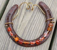 Hey, I found this really awesome Etsy listing at http://www.etsy.com/listing/101996077/tangerine-twist-beaded-horseshoe-wall