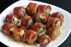 Candied Bacon Wrapped Brussels Sprouts with Maple Dijon Glaze The dish to end all Brussels Sprouts dishes! Impress your guests with this Fancy Schmancy dish that's Easy Peasy to make! Candied Bacon Wrapped Brussels Sprouts with Maple Dijon Glaze Bacon Wrapped Brussel Sprouts, Brussels Sprouts, Coconut Dessert, Candied Bacon, Roasted Bacon, Onion Gravy, Gateaux Cake, Snacks, Pot Roast