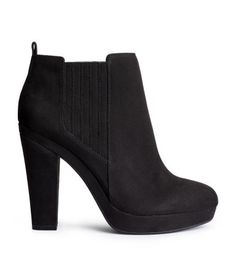 Ankle boots in imitation suede. Covered elastication in sides. Rubber soles. Platform front height 3/4 in., heel height 4 1/4 in.