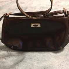 Vintage Guess Purse Solid black leather bag clutch size with a shoulder strap. Bag is in good shape, stitching is tight. Has some minor flaws on the inside of the bag. Lining has some light stains but I have not tried to get them out. Guess Bags Mini Bags