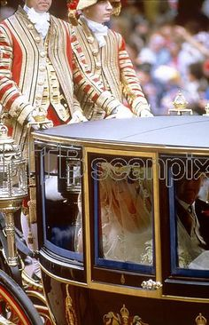 Sarah Ferguson, later Duchess of York, just visible through the windows of the royal coach as she travels to Westminster Abbey for her marriage to Prince Andrew, Duke of York on 23 July 1986.