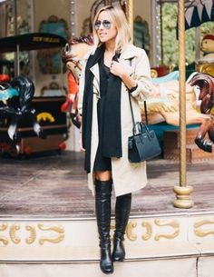 dress with leather boots and camel coat