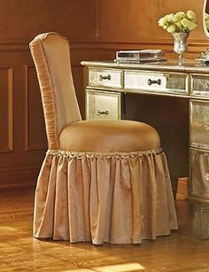 Make your daily beauty routine more glamorous with the Whitney Vanity Stool; a shimmering, beautiful  seat draped in Goldenrod fabric.