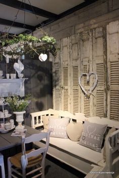 This is a little bit frou-frou for me - but I love the ideas of shutters on a bare wall for some drama and texture.