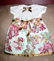 This is just made from a onesie, some fabric and ribbon...sew a little...