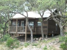The Lookout cabin's porch overlooking Walnut Canyon in Fredericksburg, TX