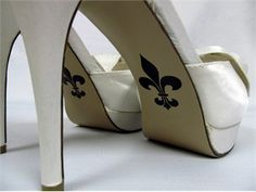 fleur de lis on the bottom of wedding shoes, cute idea for New Orleans themed wedding