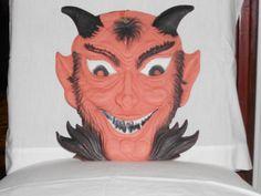 embossed devil face