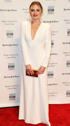 Margot Robbie in a white Calvin Klein dress