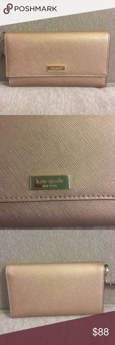Kate spade rosegold wristlet Kate spade rosegold wristlet. NWT. I bought for New Year's Eve but ended up not using it. Holds cellphone (not iPhone plus). Also holds five cards kate spade Bags Clutches & Wristlets