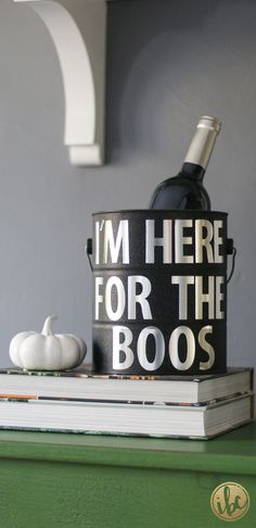 Chill Halloween party spirits in a glamorous DIY ice bucket. Michael Wurm gets creative with Halloween decor by transforming a plain paint bucket with sparkle spray paint and metallic lettering. Click to get the details of this spooktacular addition to your bar station. #halloweenpartydecor #halloweenstuff