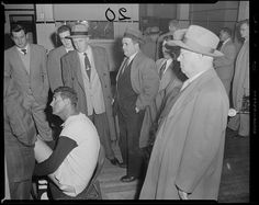 Ted Williams in clubhouse at Fenway with newsmen 1950 (approximate)