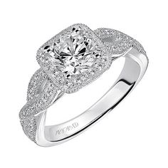 Lizbeth is a#diamondhalo #engagementring with milgrain detail and an open twist shank. It's classic but with a fashionable twist for the modern bride!