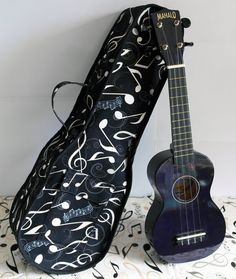 A pdf sewing pattern from SusieD Designs to sew a Ukulele Caseto download and print. This modern, soft-cover case is perfect for safely storing a Ukulele. It is