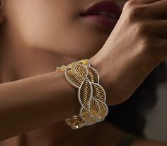 THE PRACHAL BANGLE        Diamond Bangle In 18Kt Yellow Gold (69.7 gram) with Diamonds (4.3510 Ct)
