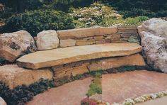 how about a cabin in the woods with a boulder and ledger stone bench?