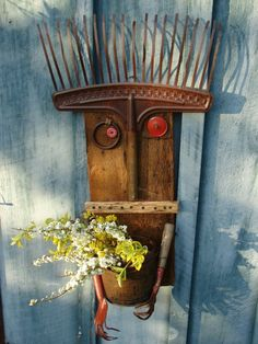 """""""whimsical rake planter or yard art - attach old rake on salvaged wood, add bike reflector or gaskets with bottle caps for eyes, wood strip for mouth, attach old pail with holes drilled for drainage, attach old garden forks for """"hands"""" - that's it! Garden Whimsy, Garden Junk, Garden Items, Garden Tools, Garden Crafts, Garden Projects, Garden Art, Garden Design, Fairies Garden"""