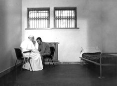 Pope Saint John Paul II meets with Mehmet Agca, the man who attempted to assassinate him, 1983.
