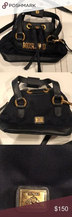 90s Moschino mini bucket bag with GHW 1990's Navy Moschino mini crossbody bucket bag nylon and leather with GHW. It has a long strap that is not adjustable with a drop that  is approximately 22 inches. It can be removed. It has been in a closet for many years. No rips on the inside. It has been used but is in very good condition. I do not have the dust bag Moschino Bags Crossbody Bags