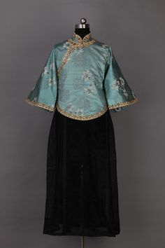 "A more elaborate version of the typical blue and black ""New Culture Attire"" worn by female students; Sotheby's"