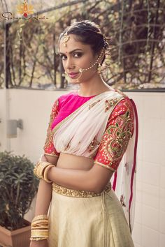 Indian Blouses - Off-White Silk Ledge ng a with a Hot Pink Blouse   wed me good:-)    Attached White Net Depart a Silhouette with a Hot Pink Blouse and Coral Sleeves with Embroidery, Gold Nath #wedmegood #lehengas #choli #dupatta #indianbride #indianwedding #silk