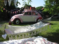 ShabbyTräume:  Summer picnic in a country garden.  This gorgeous pink VW Käfer would be allowed to park in my garden too, if my garden would be big enough that is lol