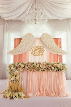 Wings are pretty, but I just need the table with those fresh flowers