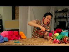 how to make pompoms in bulk. This girl is too cute.
