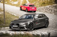 The Audi RS6 Avant and RS Q3 sit waiting to tackle some of the greatest driving roads in the world.