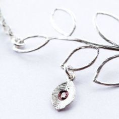 This gorgeous orchid bracelet is ideal for any special occasion.    Handmade using sterling silver and rhodium which is a precious metal, a member of the platinum family. Rhodium is used on the orchid and branch to provide a surface that will resist scratches and tarnish.    This also has the option of adding more charms. Custom Initial leaf, real orchid preserved in resin or any of your own charms.  Standard length is 7″ $45 Pearl White, Precious Metals, Orchids, Special Occasion, Initials, Resin, Charms, Swarovski, Surface