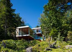 Gambier Island House by OMB cantilevers over a rocky cliff face