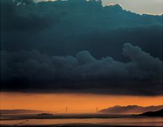 Looks like the Golden Gate bridge possibly, at sunrise or sunset. Photo by...Richard Misrach