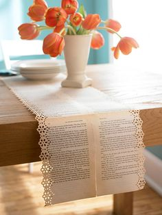 Lacy Table Runner made with discarded book pages            Create conversation at the dinner table with this out-of-the-ordinary runner. A discarded book with soft, worn pages works best. Lay the pages flat on the floor in the length and width you'd like your runner. On the back, carefully tape the pages together. Use a crafts decorative-edge punch to create a border that suits your style