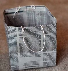 Make a gift bag from a newspaper.