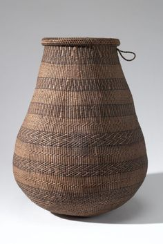 Africa | Basket with lid collected in Barotseland, Sesheko; possibly Lozi or Barotse people | Plant fiber, dye, wood, coard | ca. 1907.