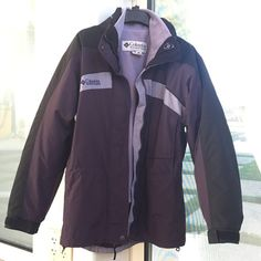 Columbia winter jacket double layer Worn maybe once or twice. Great condition. Really nice dark purple and black outside. The inside jacket unzips and can be worn separate so it's actually 2 jackets. Covers your butt for extra insulation. Zipper and button closure. Columbia Jackets & Coats