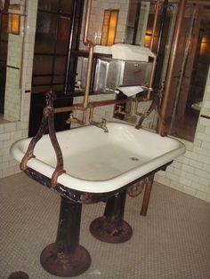 Communal sink @ Schillers Liquor Bar NYC    Again, repurposed materials for funky bathroom decor
