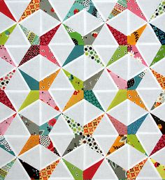 Tutorial for creating paper pieced pattern of this block in any size is at http://pitterputterstitch.blogspot.fr/2012/11/paper-pieced-kaleidoscope-tutorial.html