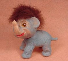 Remember these?  They were produced by the Danish Troll Company, founded by Thomas Dam in the 1930s.  This one is just like the troll-faced elephant given to Kitty in Summer of '76.
