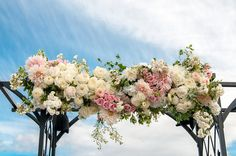 Stunning wedding arch decor idea - cream, pink and white hydrangeas, roses, dahlias and greenery {Affinity Photography}