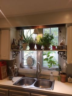 Herb shelf above the kitchen sink