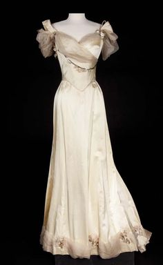 """Ivory satin two–piece period gown with chiffon trim.  Worn by Donna Reed as """"Gladys Hallward"""" in The Picture of Dorian Gray. (MGM, 1945) Costumes by Irene Sharaff"""