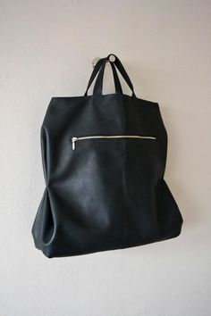 Folded shopper by Atelier Judith van den Berg €185. Handmade black leather bag.