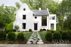 Architect Yong Pak of Pak Heydt & Associates worked with the homeowners on this Dutch meets West Indies abode. // Atlanta, GA Architect Yong Pak of Pak Heydt & Associates worked with the homeowners on this Dutch meets West Indies abode. Interior Exterior, Exterior Design, Fachada Colonial, Architecture Design, Stucco Homes, Dutch Colonial, Atlanta Homes, Deco Design, White Houses