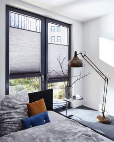 Grey bedroom blinds. Top-down/bottom up feature to customise when and where light comes into the bedroom